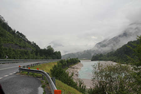 inclement weather: Mountain road in the Italian Alps. In inclement weather, the clouds swirling in the narrow gorges.