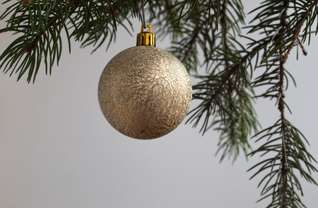 The decoration of Christmas trees. On Christmas eve, on the branches of a spruce hung toys and garlands.