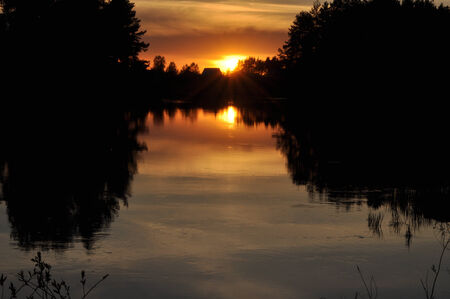 Sunset on a quiet river. May the landscape of the national Park Meshera, Russia. photo
