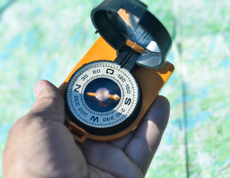 astray: Compass in hand. Open the magnetic compass holds the left hand men.