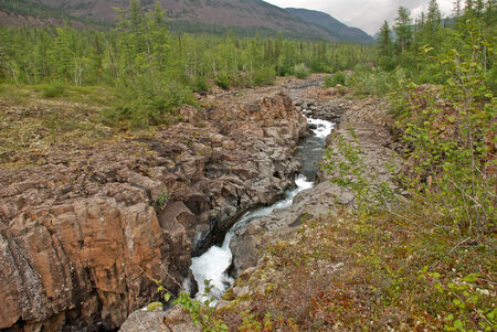 Photo waterfall, made during a hike in 2011 on the Putorana plateau. Taimyr Peninsula, Russia. Stock Photo