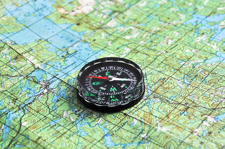 The compass on the map. The magnetic compass is located on a topographic map.