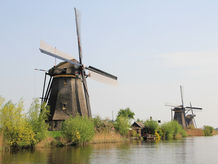 dyke: Windmills on the canal bank. Typical Dutch rural landscape in the vicinity of Amsterdam.