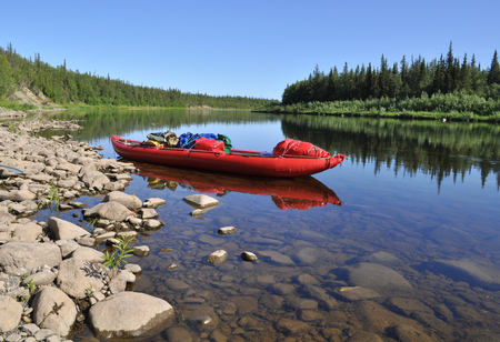 urals: Taiga river Paga, Russia, the Polar Urals. Virgin Komi forests, red boat on the river.
