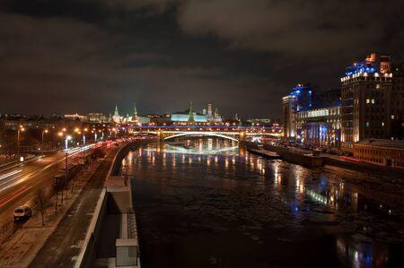 The Moscow Kremlin at night. View of the Moscow Kremlin and the Bolshoy Kamenny bridge at night.