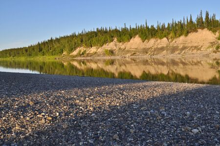 Evening on the Ural river. Polar Ural, Komi Republic, the beaches along the banks of the river.
