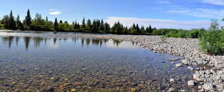 Panoramic river landscape in the polar Urals. Summer in the Russian North is short and beautiful.