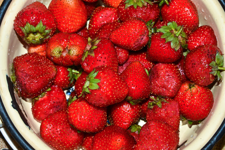 medium group of object: Ripe strawberries. Bright red wet berries strawberry close-up.