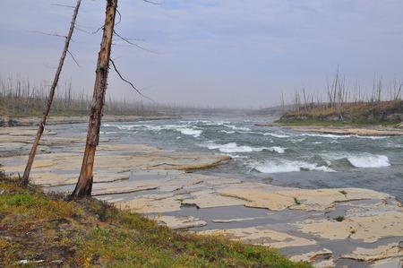 falling tide: Threshold Oron on the river Fish, Putorana Plateau, Taimyr, Russia.