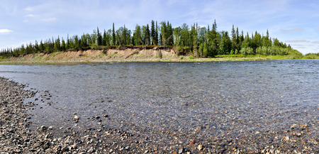 urals: Panorama of the river landscape. Pebble river banks Kokpela on the Polar Urals. Stock Photo