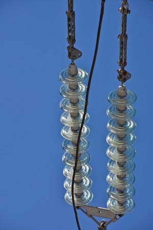 insulators: Insulators power lines. Photo of power lines against the blue sky.