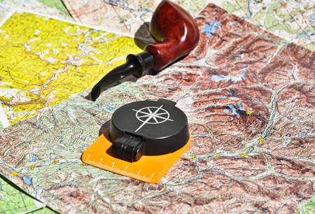 pipe smoking: Map, compass and pipe Smoking area. The indispensable accessories for travel and adventure.