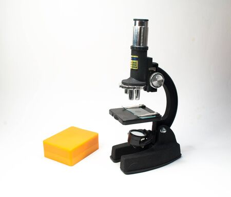scientific equipment: The microscope on a white background. Scientific equipment - optical device in a biological laboratory.