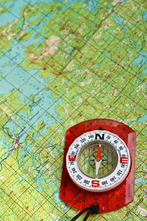 topographic: The compass on the map. Photo magnetic compass located on a topographic map. Stock Photo