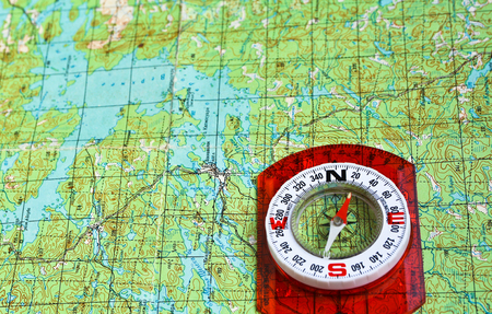 navigational light: The magnetic compass and topographic map. Travel compass and map symbols adventures. Stock Photo