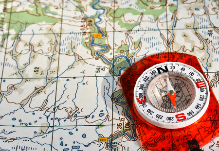 orienteering: Navigation equipment for orienteering. Magnetic compass and topographic map.