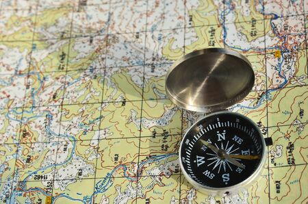 topographic: Navigation equipment for orienteering. Magnetic compass and topographic map.