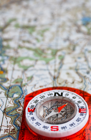azimuth: The magnetic compass is located on a topographic map. Equipment for travel - map and compass. Stock Photo