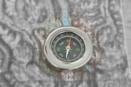 orienteering: Orienteering using a map and compass. Magnetic compass on a topographic map. Stock Photo