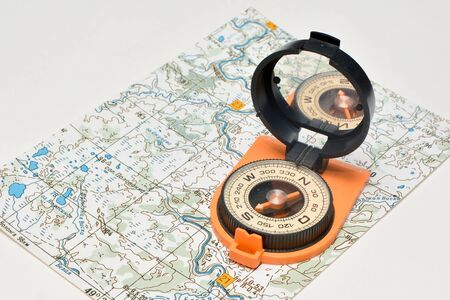topographic: Compass & map - friends travelers. Magnetic compass on a topographic map.
