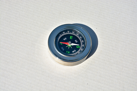 azimuth: Magnetic compass. Compass - navigation instrument, on a white background.