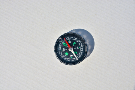 Magnetic compass. Compass - navigation instrument, on a white background.