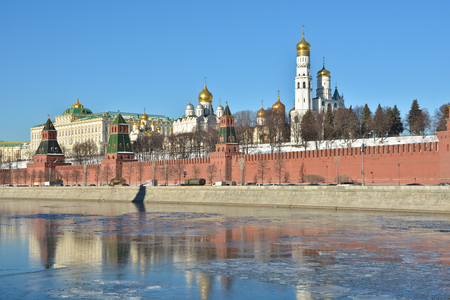 Kremlin embankment in Moscow. The walls of the Kremlin and churches from the side of the Moscow river. Stock Photo