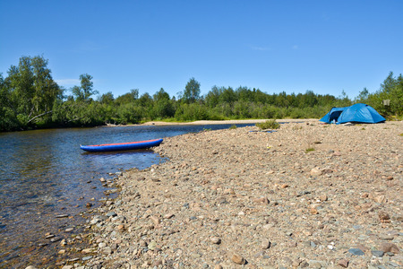 va: Boat and tent on the Bank of the river. Tourism in the national Park Yugyd VA in the Northern Urals. Stock Photo