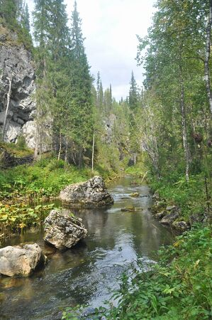 va: Brook among the rocks in the national Park Yugyd VA. Virgin Komi forests. Northern Urals, Russia.