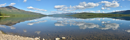 clear waters: Lake panorama on the Putorana plateau. Summer water landscape in Northern Siberia. Stock Photo