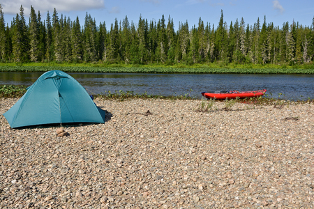 Journey through the national Park. Tent tourist on the banks of the taiga rivers of the Northern Urals. Stock Photo
