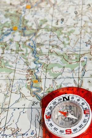 Compass on the map. Navigation tools to avoid getting lost. Stock Photo