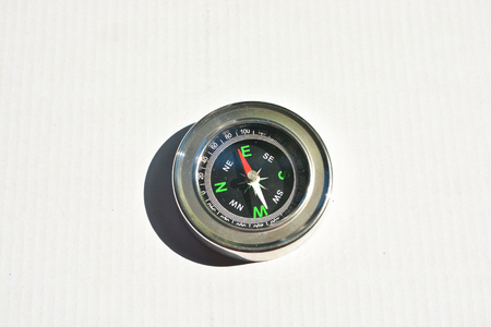 Compass on a white background. A navigation tool for travel and adventure. Stock Photo