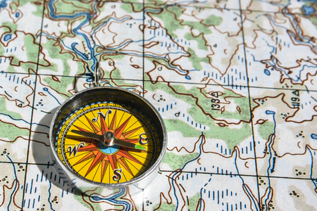 Compass and map. Navigation tools to avoid getting lost.
