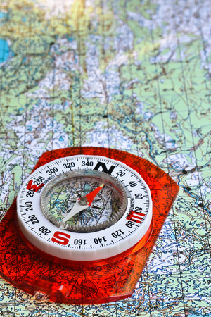 No orientation no travel. The tools of orienteering - map and a magnetic compass. Stock Photo
