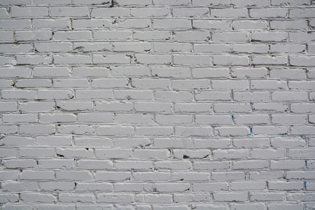 Texture of a painted brick wall. Background from the surface of a brick building. Stockfoto