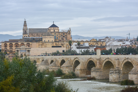 Cordoba in November. Roman Bridge and Mezquita. Autumn in Spain, Cordoba, Andalusia.