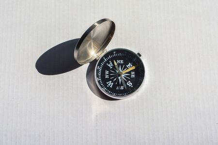 Compass on a white background. Old reliable navigation device.