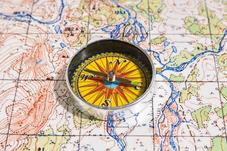 Map and compass. Navigation tools, so as not to get lost in travel.