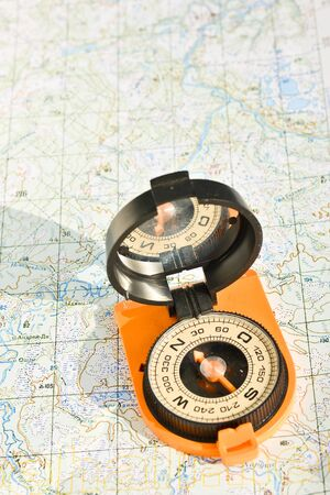 Map with compass. Necessary navigational tools, they will not get lost.