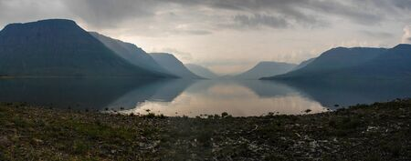 Panorama of lake Lama on the Putorana plateau. Water landscape of Eastern Siberia.
