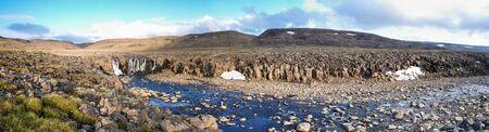 Panorama of the waterfall on the Putorana plateau. Mountain landscape of Eastern Siberia. Imagens