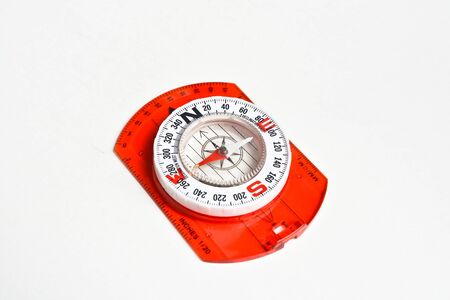 Compass on white. Magnetic navigation tool for orienteering. Imagens