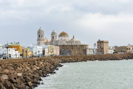 Promenade and Cathedral of Santa Cruz in Cadiz, Spain. A city in the south of Spanish Andalusia, on the shores of the Atlantic Ocean. Фото со стока