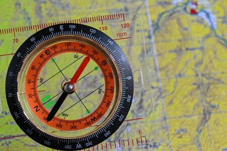 Going on a trip! Compass on the background of a topographic map.