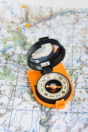Compass and map. Navigation tools so as not to get lost. Фото со стока