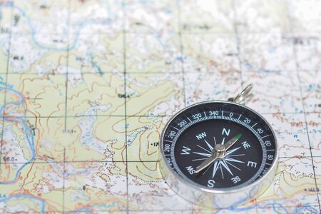 Compass and map. Navigation tools so as not to get lost. 版權商用圖片