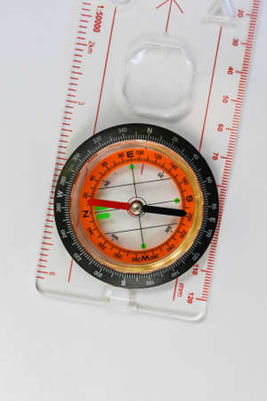 Compass. Magnetic compass, a navigation tool is located on a white background.