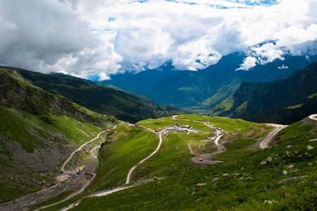 himalaya: Indian Himalayas landscape. Mountains, green meadows, clouds and river.