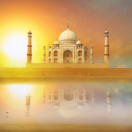 Taj Mahal India Sunset. Agra, Uttar Pradesh. Beautiful Palace with reflection in river. Wonderful landscape. photo
